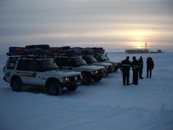 4 workers vehicles sunset arctic.jpg