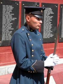 DSCN3168 guard at memorial wall.jpg